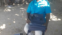 Health worker Susana sitting in her village