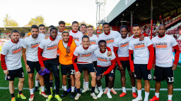Team photo of Brentford FC in Malaria No More t-shirts