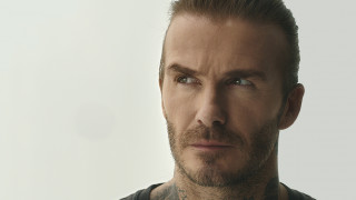 David Beckham looking towards a mosquito