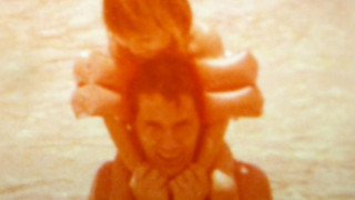 An old photo of a dad with his little girl on his shoulders